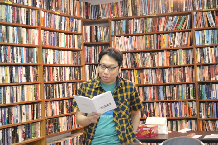 "GAP Gutierrez reading ""Blood on the Cornerstone"". (Migrant Writes, Q8 Books, March 14)"